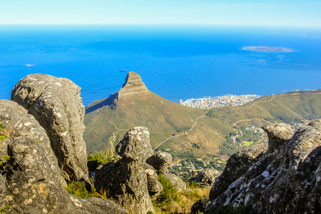 Table Mountain National Park, Trail Hike. The plateau, flanked by Devils Peak to the east and by Lions Head to the west, forms a backdrop to Cape Town.