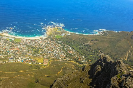 Aerial view of Camps Bay Beach near Cape Town as seen from Lions Head within the Table Mountain National Park in South Africa, Western Cape. Camps Bay Beach is a great popular white sand beach.