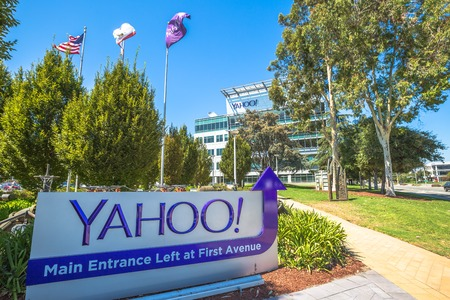 web portal: Sunnyvale, California, United States - August 15, 2016: Yahoo Headquarters with American Flag and Yahoo icon.Yahoo is a company providing internet services founded in 1994 by David Filo and Jerry Yang