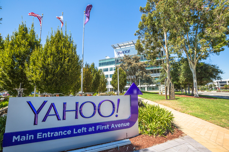 yahoo: Sunnyvale, California, United States - August 15, 2016: Yahoo Headquarters with American Flag and flag with Yahoo icon on background.