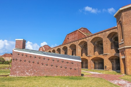 Inner wall, houses and courtyard in Fort Jefferson at Dry Tortugas National Park, Florida. Old sections of Fort Jefferson lie in ruins within the forts massive courtyard.