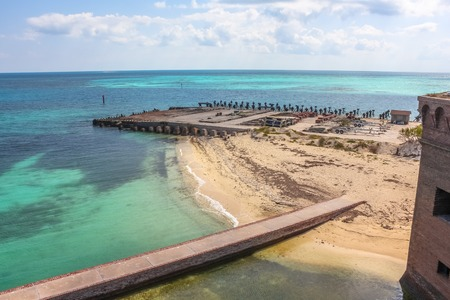 North Coaling Dock Ruins of Fort Jefferson in Dry Tortugas National Park situated at the southwest corner of the Florida Keys reef system ed is one of the United States most remote national parks.