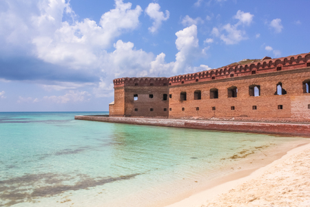 The crystal clear waters of the Gulf of Mexico surround Civil War Historic Fort Jefferson in the Dry Tortugas National Park known for its famous bird and marine life. Editorial