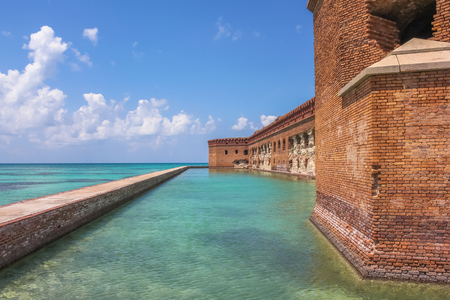 Northern Side of Fort Jefferson on Dry Tortugas National Park, Florida. The brick moat around Fort Jefferson with the crystal clear waters of the Gulf del Messico surround it.