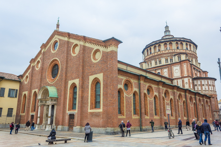 Milan, Italy - November 15, 2016: Milans famous church Santa Maria Delle Grazie, hosting in its refectory, The Last Supper mural painting by Leonardo da Vinci. side view