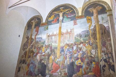 Milan, Italy - November 15, 2016: The Crucifixion mural painting of Giovanni Donato Montorfano in the Refectory of Santa Maria Delle Grazie Italian church.