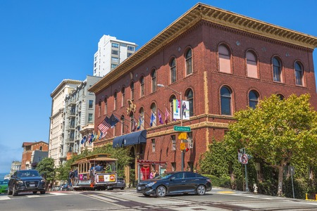 San Francisco, CA, United States - August 17, 2016: a Cable Car stop to University Club of san francisco in California and Powell streets, where the three lines intersect in a set double crossovers.