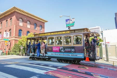 San Francisco, California, United States - August 17, 2016: a Cable Car Powell-Mason Line, cross to California and Powell streets near University Club of San Francisco. Editorial