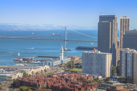 Aerial panorama close up of San Francisco Financial District, Embarcadero and Oakland Bridge, from top of Coit Tower on sunny day. California, United States.