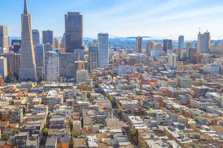 Aerial view of San Francisco Financial District and Transamerica Pyramid skyline from the top of Coit Tower, California, United States. Coit Tower is atop Telegraph Hill.
