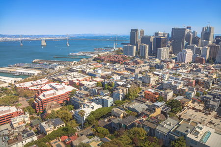 Aerial panorama of San Francisco Financial District, Embarcadero and Oakland Bridge, from top of Coit Tower on sunny day, California, United States.