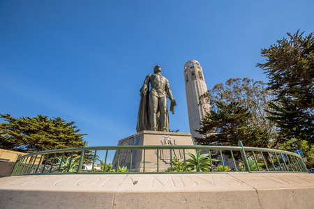 Perspective view of the statue of Christopher Columbus and Coit Tower. North Beach, on Telegraph Hill, California, United States.
