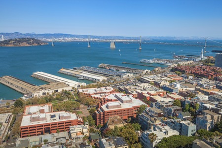 Aerial panorama of San Francisco North Beach, Embarcadero and Oakland Bridge, from top of Coit Tower on sunny day. Telegraph Hill, California, United States. Stock Photo
