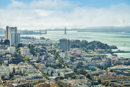 Aerial view of San Francisco skyline. Panorama of the Golden Gate Bridge, Fishermans Wharf and North Beach from top of Coit Tower on sunny day, California, United States.