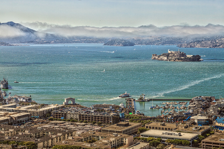 alcatraz: San Francisco, California, United States - August 14, 2016: Aerial view of Alcatraz Island, Hyde Street Pier in Fishermans Wharf and Maritime National Historical Park, from top of Coit Tower.