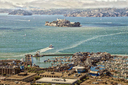 San Francisco, California, United States - August 14, 2016: Aerial view of Port of San Francisco, Alcatraz Island and Fishermans Wharf from top of Coit Tower. Editorial