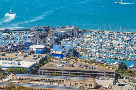 San Francisco, California, United States - August 14, 2016: Aerial view of Port of San Francisco, Pier 39 and Fishermans Wharf from top of Coit Tower in a sunny day.