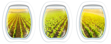 Plane windows on Napa Valley at sunset, California, United States, from a plane through the porthole window. Copy space. Stock Photo