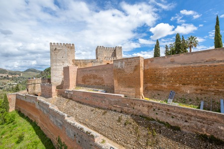 Alhambra de Granada, Spain - April 17, 2016: The military fortress wall of the Alcazaba in Alhambra of Granada,  Andalusia, Spain.