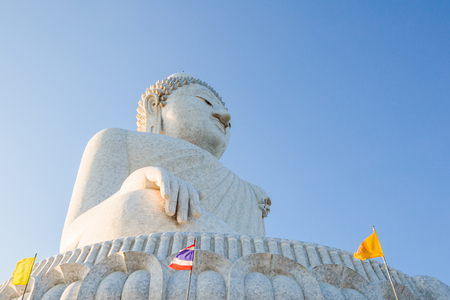 Perspective view from below of the popular Big Buddha on Nakkerd hills of Ao Chalong in Phuket, Thailand in a sunny day. Symbol of peace and spirituality. Side view. Stock Photo
