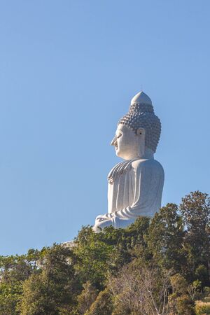 Side view of the Big Buddha in the blue sky. Nakkerd hills in Ao Chalong, Phuket, Thailand.