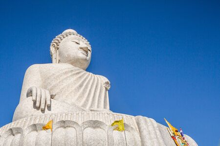 The Big Buddha in the blue sky, front view. Nakkerd hills in Ao Chalong, Phuket, Thailand. Phukets Big Buddha is one of the islands most important and revered landmarks on the island.