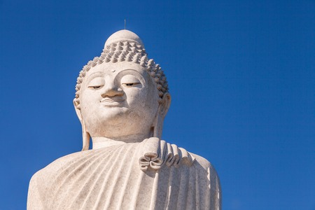 Close up of the Big Buddha head. Front view. Nakkerd hills in Ao Chalong, Phuket, Thailand. Visible almost everywhere, the Big Buddha has become one of the most popular attractions in Phuket Stock Photo
