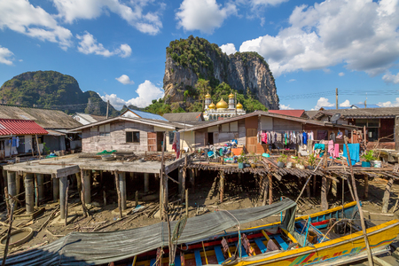 Phang Nga National Park, Krabi, Thailand - January 6, 2016: Historical floating Koh Panyi settlement, also known as Koh Panyee, muslim fishing village built on stilts of Phang Nga Bay, Krabi, Thailand Editorial