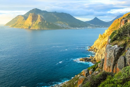 scenic drive: The Lookout Point at sunset in Hout Bay from the famous and scenic Chapmans Peak Drive, Cape Town, South Africa. Stock Photo