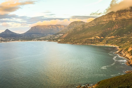 chapmans: Aerial view of scenic Chapmans Peak Drive at sunset, Cape Town, South Africa is considered one of the most beautiful streets in the world.