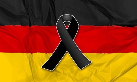 terrorist attack: Black ribbon on flag of Germany in memory of victims of terrorist attack. Stock Photo