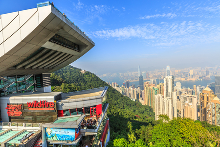 Hong Kong, China - December 7, 2016: The Peak Tower and rooftop restaurant atop Victoria Peak in a sunny day. The Peak Tower and spectacular views of Victoria Harbour and skyline of Hong Kong. Editorial