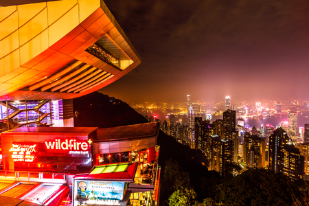 top 7: Hong Kong, China - December 7, 2016: close up of Peak Tower and rooftop restaurant by night. The Sky Terrace 428, the viewing platform on top of the Peak Tower, is a icon building in Hong Kong.