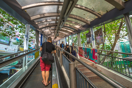 Hong Kong, China - December 4, 2016: People using the Centra Mid Levels escalator in Hong Kong, the longest outdoor covered escalator system in the world. 에디토리얼