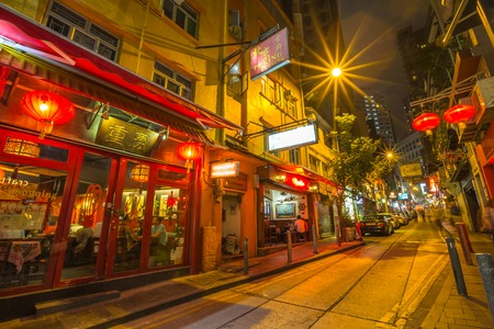 Hong Kong, China - December 10, 2016: Peking cuisine in Elgin Street by night, popular road Soho district in Central Hong Kong, famous for bars, restaurants, clubs and nightlife. Editorial