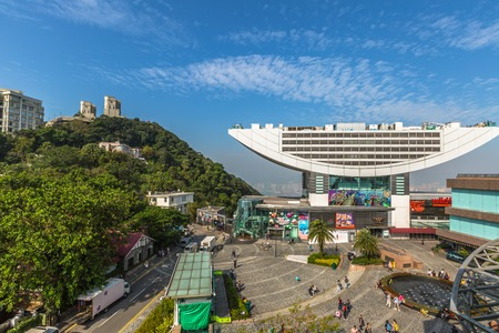 Hong Kong, China - December 7, 2016: aerial view of Peak Tower, iconic landmark, from Peak galleria.The Peak Tower is the most popular attraction in Hong Kong and the islands highest viewing platform