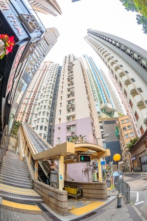 fish eye: Hong Kong, China - December 4, 2016: The final section of Central-Mid-levels escalator, the worlds longest escalator system, from Mosque Street to Conduit Road. Fish eye lens view.