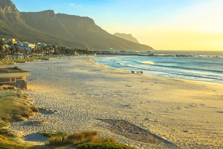 Popular Camps Bay Beach with its white beach, attracts a large number of foreign visitors and is an affluent suburb of Cape Town in Western Cape, South Africa. Shot taken at sunset. Stock Photo