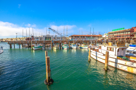 San Francisco, California, United States - August 14, 2016: boats docked at Pier 39, Fishermans Wharf district. San Francisco travel summertime. Pier 39 Marina waterfront. Popular tourist attraction.