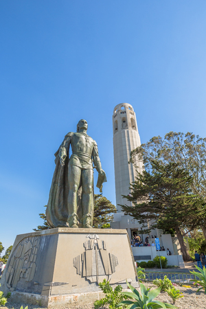 coit: San Francisco, California, United States - August 14, 2016: The Coit Tower and a statue of Christopher Columbus in the North Beach neighborhood on Telegraph Hill, in a sunny day.