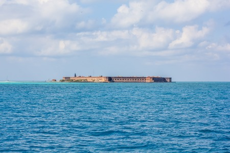 Dry Tortugas National Park is 70 miles from Key West in Florida and can be reached by ferry or seaplane. View of Fort Jefferson, a historical military fortress in Garden Key, from the boat ferry.