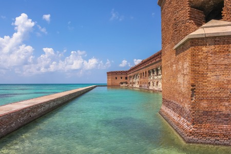 dry tortugas: Northern Side of Fort Jefferson on Dry Tortugas National Park, Florida. The brick moat around Fort Jefferson with the crystal clear waters of the Gulf del Messico surround it.