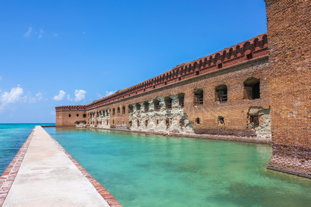 dry tortugas: Northern Side of Fort Jefferson on Dry Tortugas National Park, Florida. The brick moat around Fort Jefferson with the crystal clear waters of the Gulf of Mexico surround it.