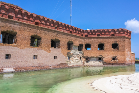 The Dry Tortugas National Park consists of seven tiny islands composed of coral reefs, white sandy beaches and the tropical waters. Fort Jefferson is a historic military fortress in the Dry Tortugas. Stock Photo