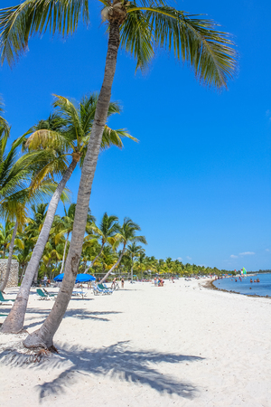 The fine white sand of Smathers Beach, Key West, Florida. Smathers Beach is Key Wests longest beach and is located on the Atlantic Ocean side. Popular tourist destination.