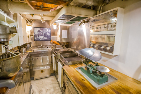 HONOLULU, OAHU, HAWAII, USA - AUGUST 21, 2016: kitchen preparation room with pots and plates of USS Bowfin Submarine SS-287 at Pearl Harbor. Historic Landmark of the Japanese attack in WW II.