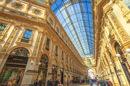 MILAN, ITALY- MARCH 7, 2017: vault hall of the Galleria Vittorio Emanuele II gallery in Piazza Duomo square. Famous fashion stores like Prada. Luxury, leisure and shopping concept.