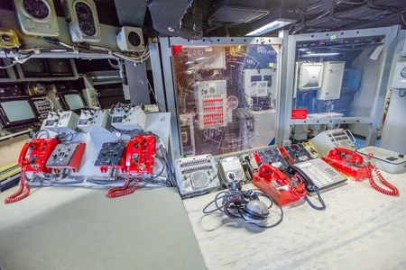 ship wreck: HONOLULU, OAHU, HAWAII, USA - AUGUST 21, 2016: Main battle station with red telephones and map in operations room of Battleship Missouri at Pearl Harbor.The end World War II was signed on this warship