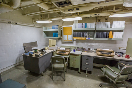 HONOLULU, OAHU, HAWAII, USA - AUGUST 21, 2016: A big office with computers and teletypewriters of Battleship Missouri at Pearl Harbor, a military Hawaiian port in Oahu island.