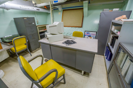 ship wreck: HONOLULU, OAHU, HAWAII, USA - AUGUST 21, 2016: technological office with computers and teletypewriters of Battleship Missouri at Pearl Harbor. The end World War II was signed on this warship